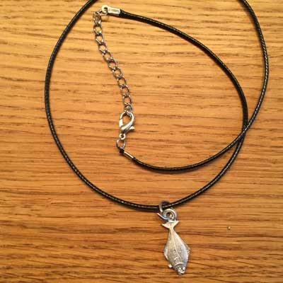 halsband liten hälleflundra arcticart örjansfiske tennfigur